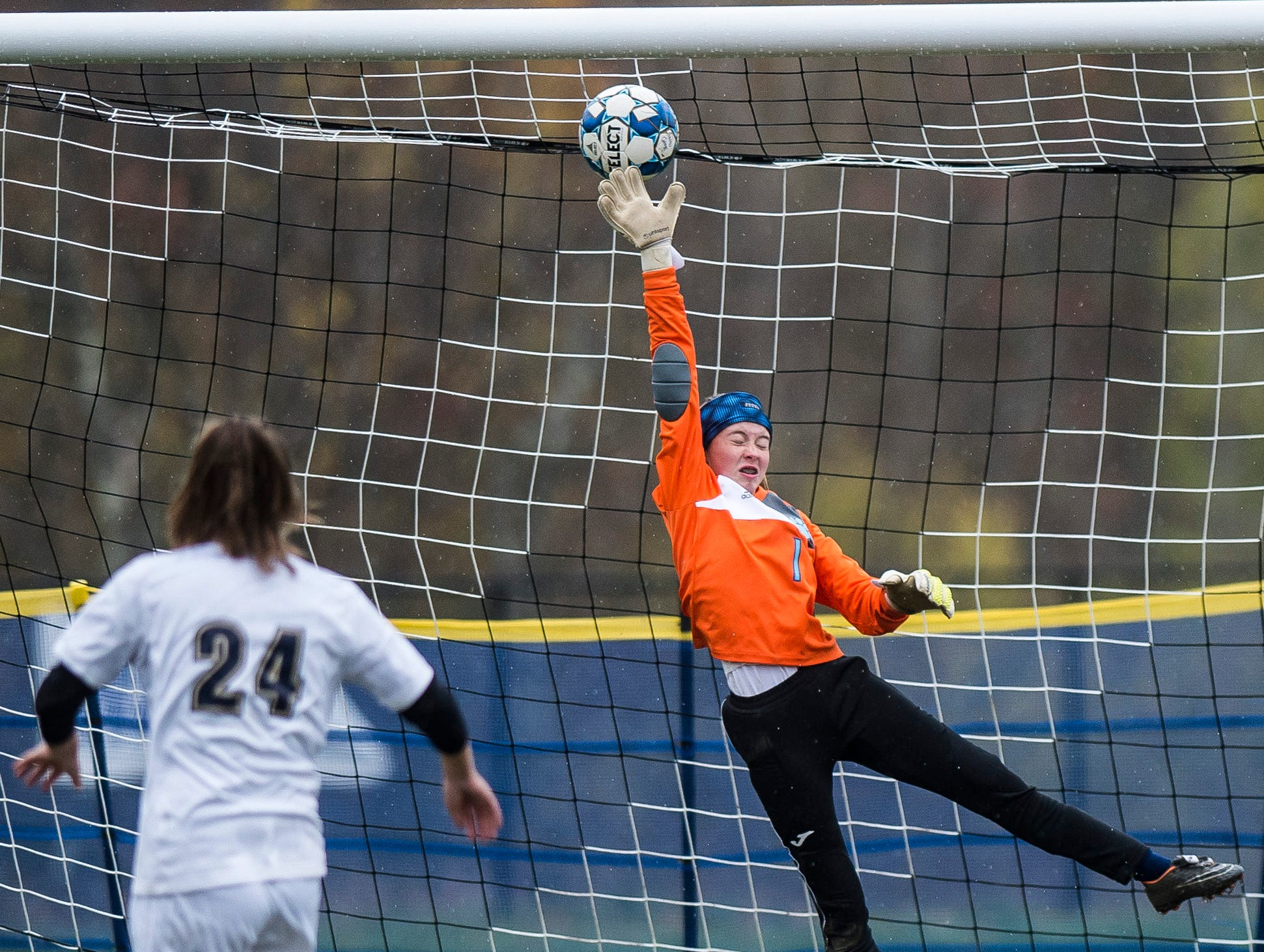 Essex #24 Emma Whitney gets their first penalty kick past MMU goalie Anna Betz during their quarter-final game in Jericho on Saturday, Oct. 27, 2018, that went into double overtime and shootout. Essex took the penalty kick contest to win, 4-1.