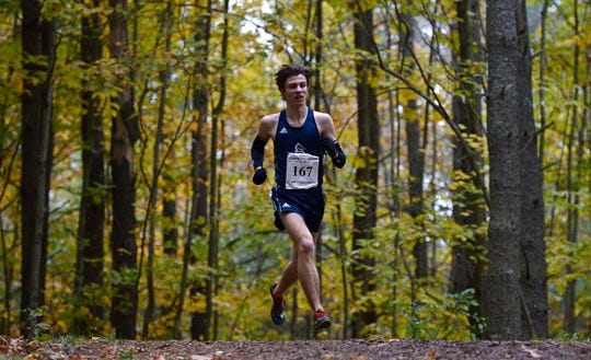Burlington's Simon Kissam competes in the Division I boys championship during the Vermont State Meet at Thetford Academy on Saturday, Oct. 27, 2018. Kissam placed second in a time of 16:59.5.