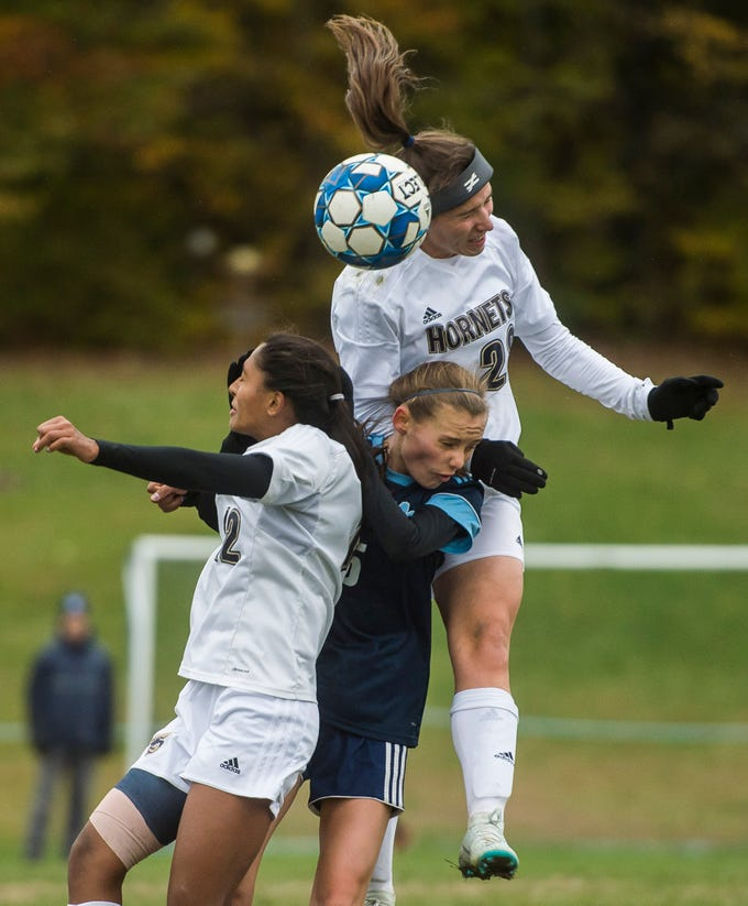 Essex #12 Souma Mitra and #22 Huntyr Poulin gang up on MMU #5 Skye Fitzhugh for the header during their quarter-final game in Jericho on Saturday, Oct. 27, 2018, that went into double overtime and shootout. Essex took the penalty kick contest to win, 4-1.