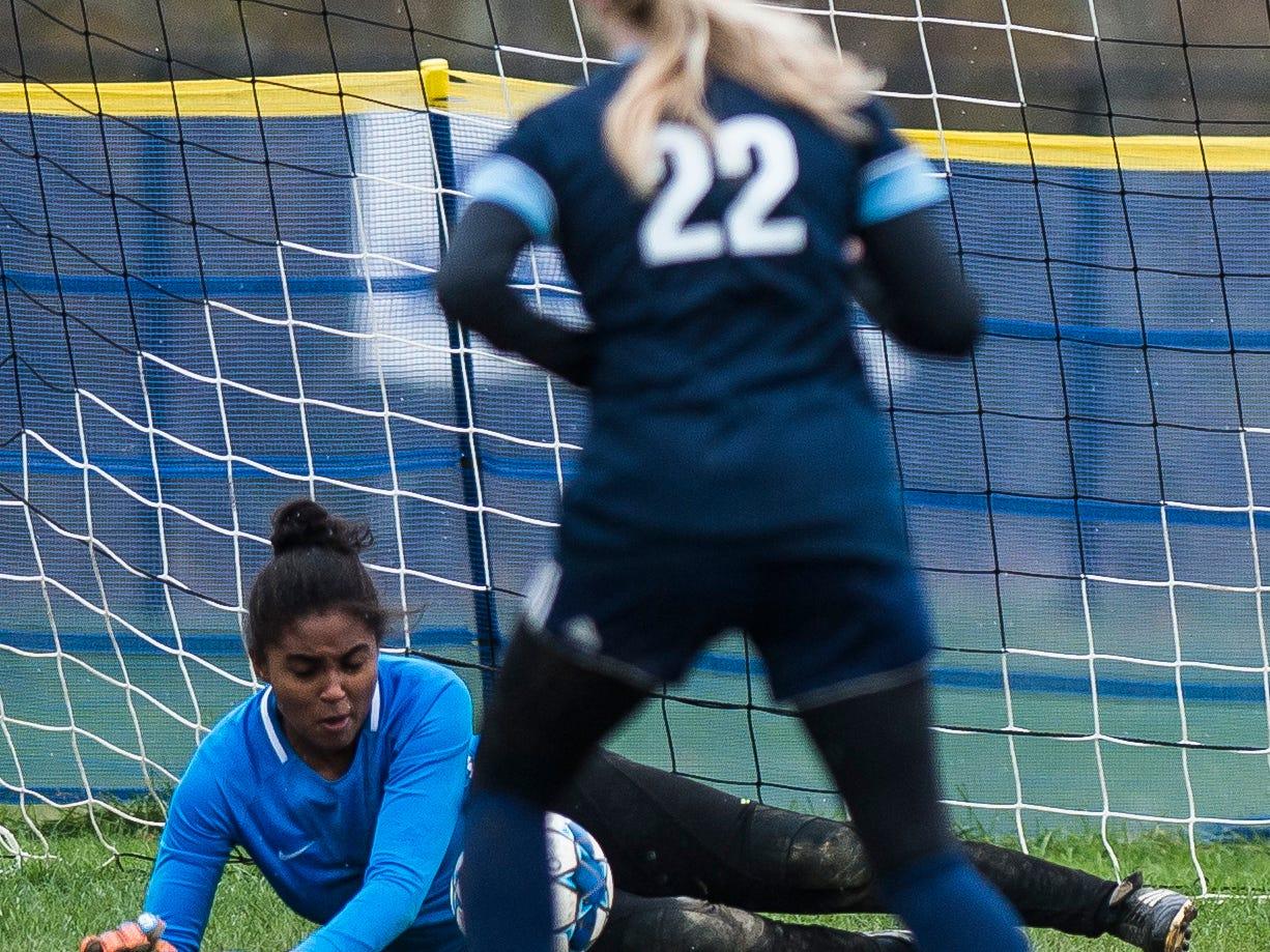 Essex goalie Yasmine Nsame saves MMU's first penalty kick from #22 Willa Clark  during their quarter-final game in Jericho on Saturday, Oct. 27, 2018, that went into double overtime and shootout. Essex took the penalty kick contest to win, 4-1.
