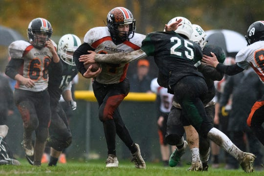 Rice's Connor Ritchie (25) tries to tackle Middlebury's Tyler Buxton (14) during the boys high school football game between the Middlebury Tigers and the Rice Green knights at Rice Memorial High School on Saturday afternoon October 27, 2018 in South Burlington.