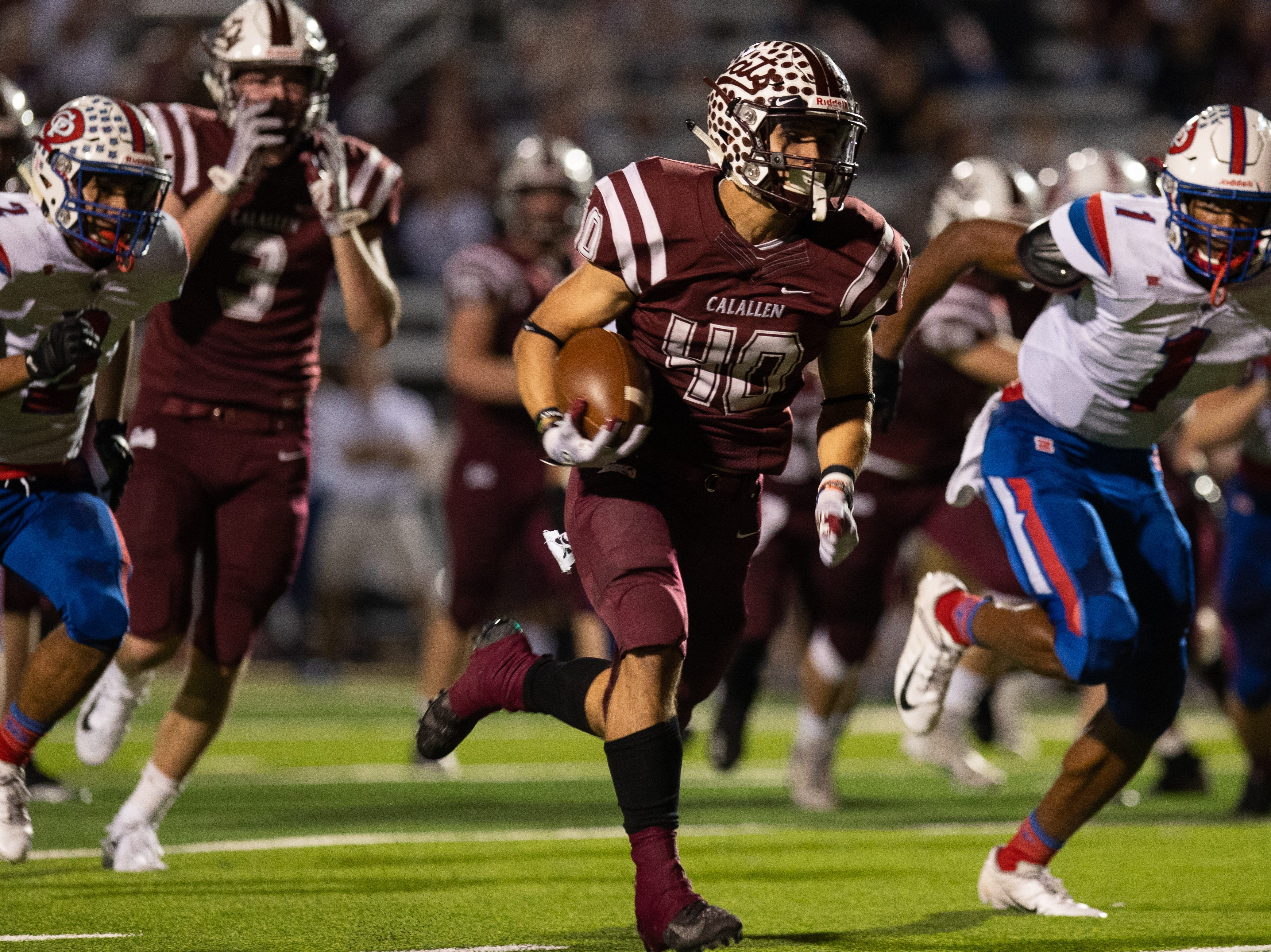 Calallen's AJ Brown runs the ball for a touchdown during the first half of their game against Gregory-Portland at Wildcat Stadium on Friday, Ict. 26, 2018.