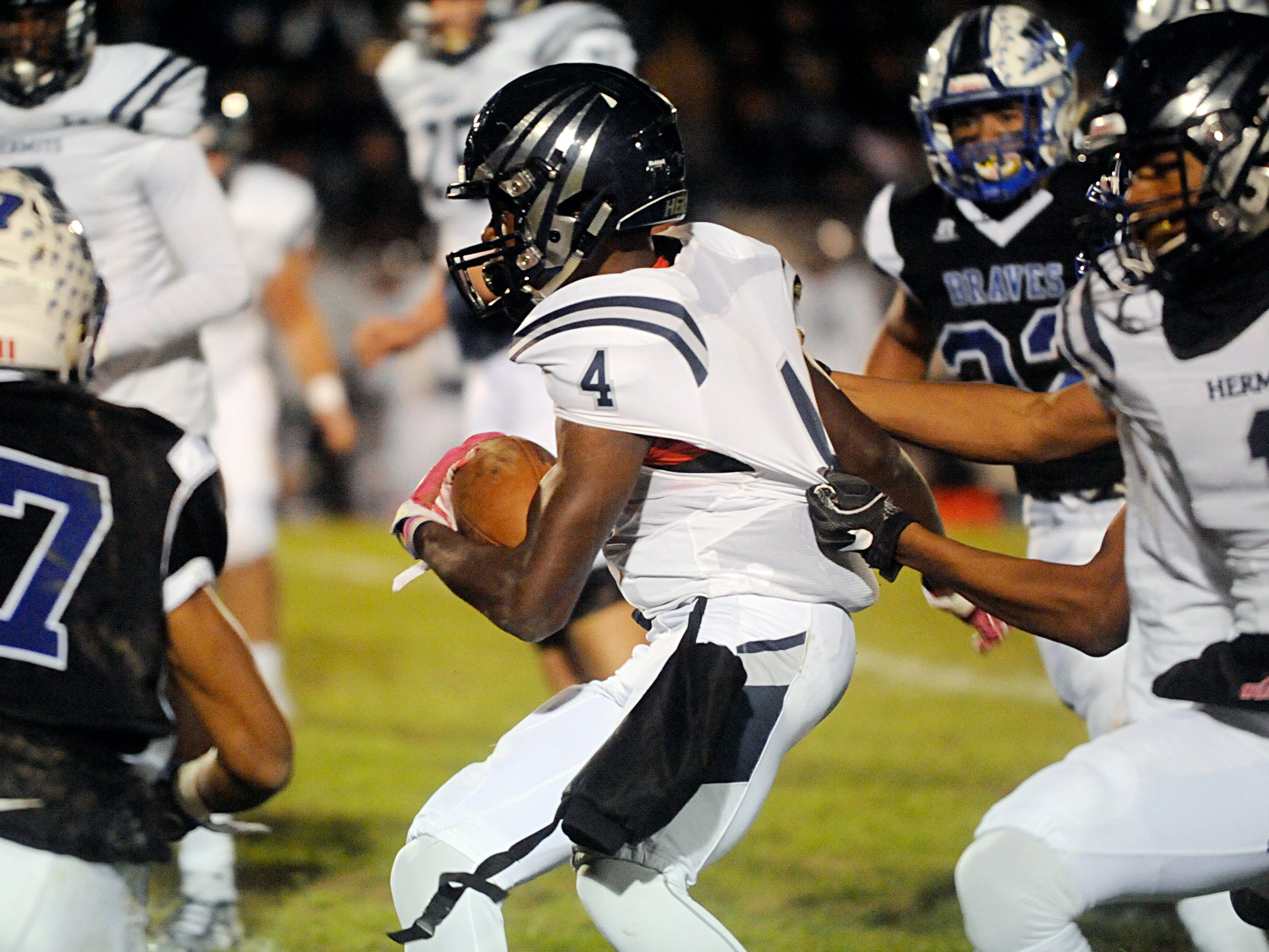 St. Augustine's Nasir Hill runs for a gain against Williamstown. The Braves topped the Hermits, 14-7, on Friday, October 26, 2018.