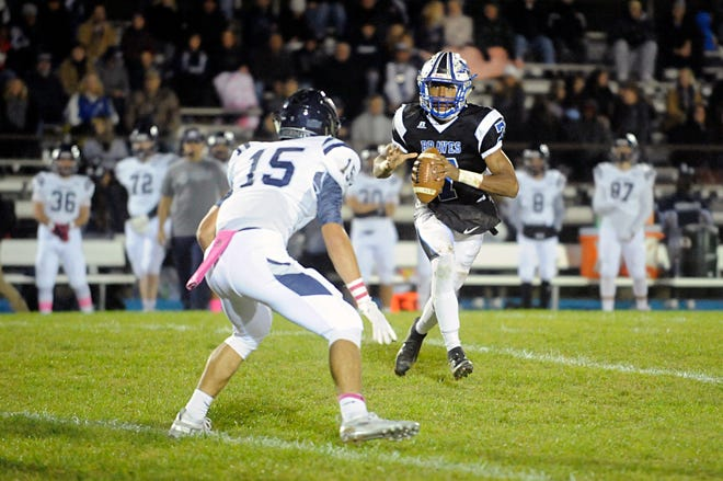 Williamstown QB, Jonathan Collins looks for a open receiver against visiting St. Augustine. The Braves topped the Hermits, 14-7, on Friday, October 26, 2018.