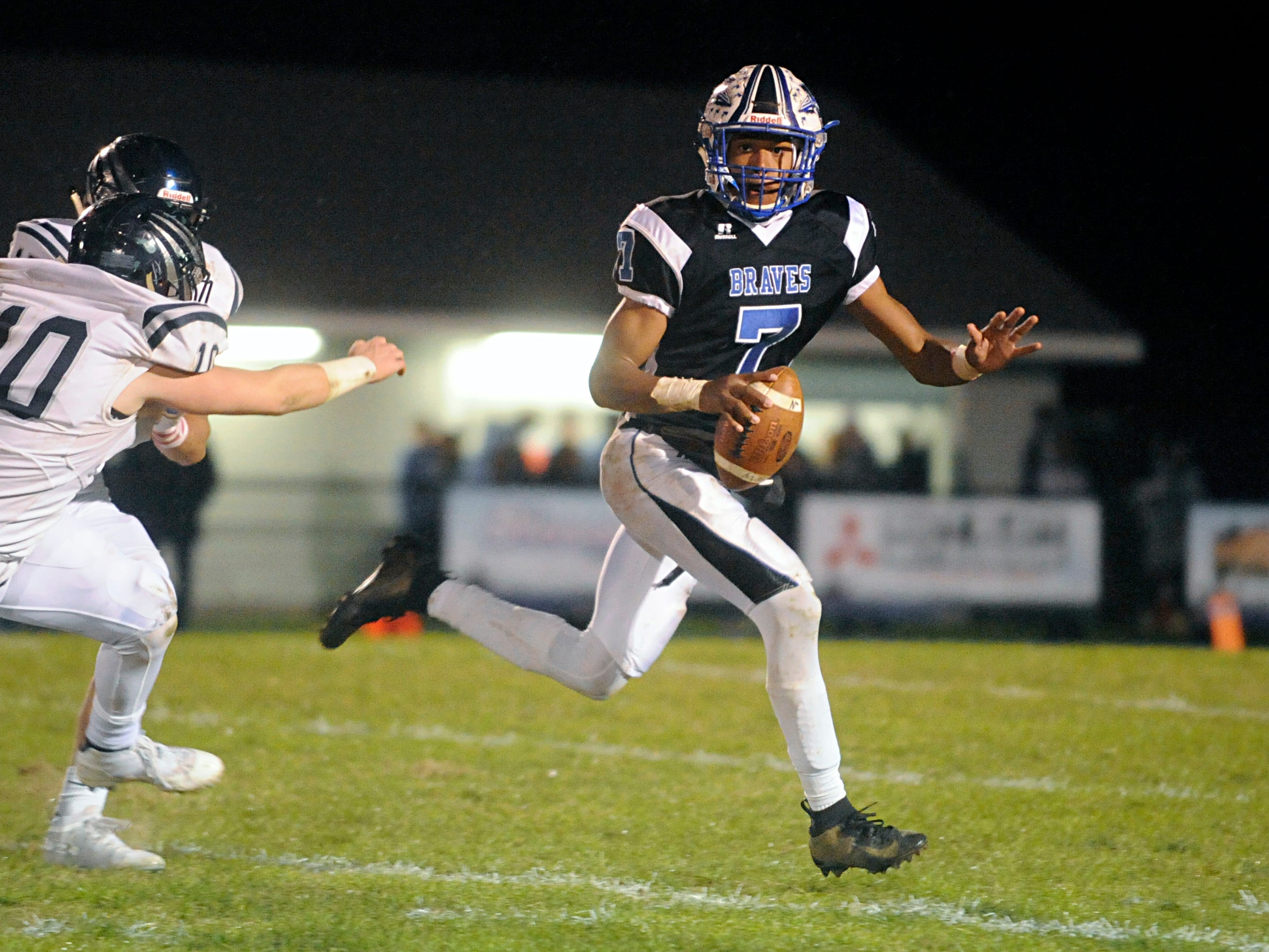 Williamstown QB, Jonathan Collins looks for a open receiver during a game against visiting St. Augustine. The Braves topped the Hermits, 14-7, on Friday, October 26, 2018.