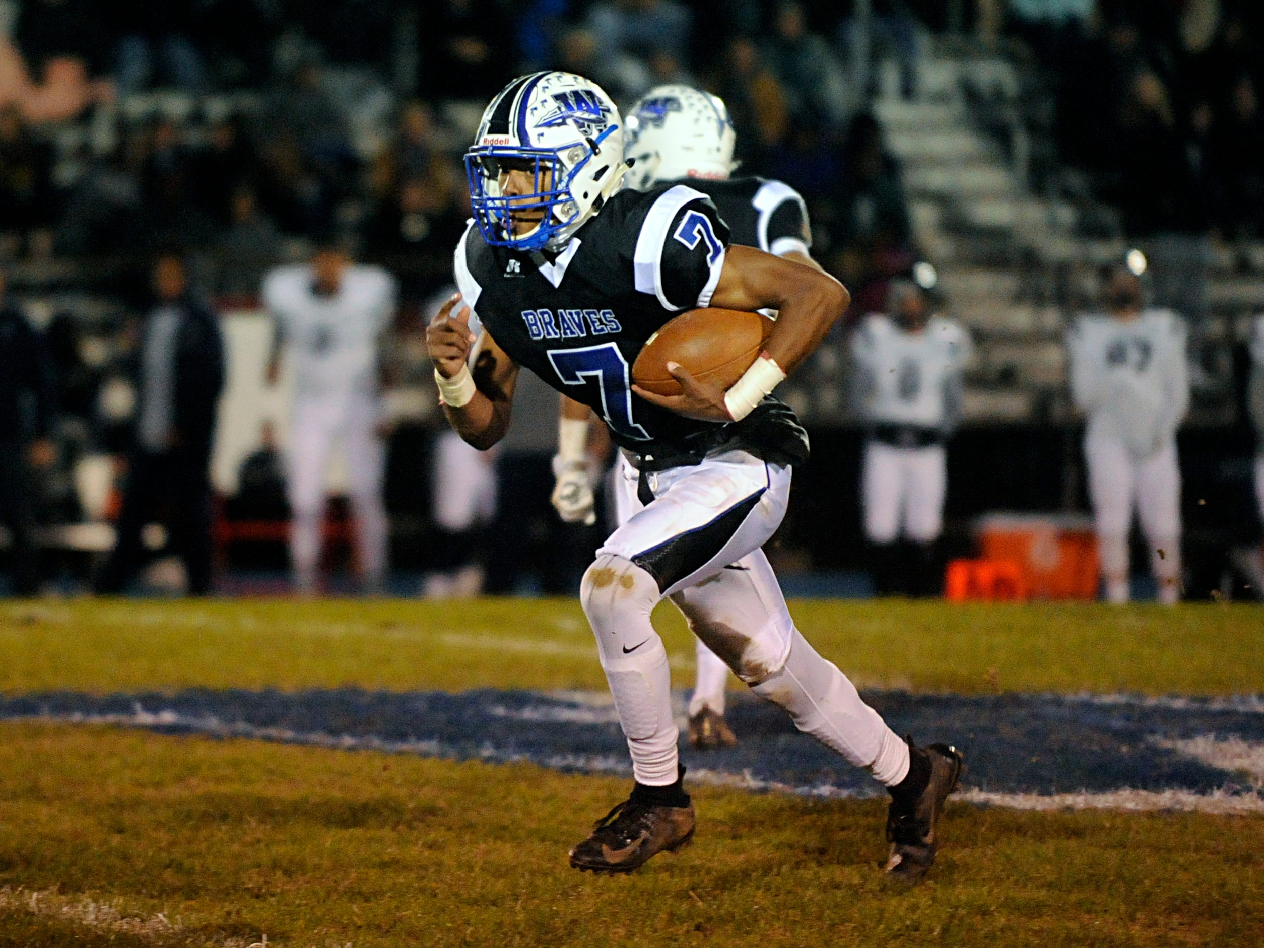 Williamstown QB, Jonathan Collins runs for a gain against visiting St. Augustine. The Braves topped the Hermits, 14-7, on Friday, October 26, 2018.