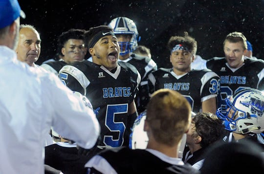 Williamstown's Wade Inge speaks to his team after a 14-7 win against visiting St. Augustine on Friday, October 26, 2018.