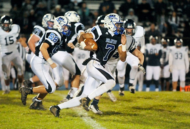 Williamstown's Jonathan Collins runs for a gain against visiting St. Augustine on Friday, October 26, 2018.