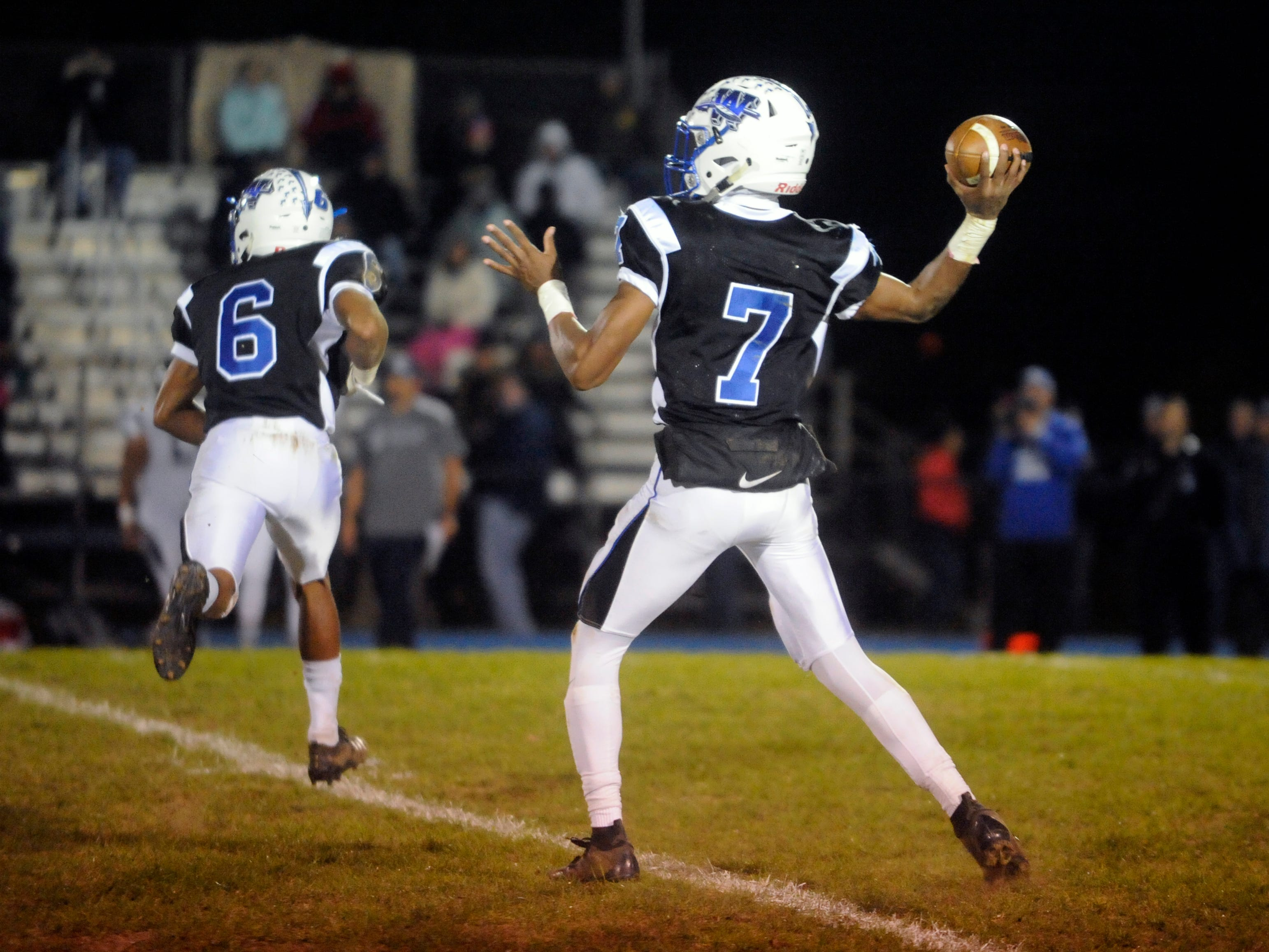 Williamstown QB, Jonathan Collins passes the ball during a game against visiting St. Augustine. The Braves topped the Hermits, 14-7, on Friday, October 26, 2018.