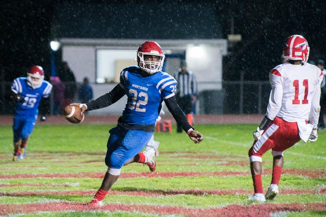 Triton's Eric Staton (32) carries the ball into the end zone for a touchdown against Pennsauken Friday, Oct. 26, 2018 at Triton High School in Runnemede, N.J.