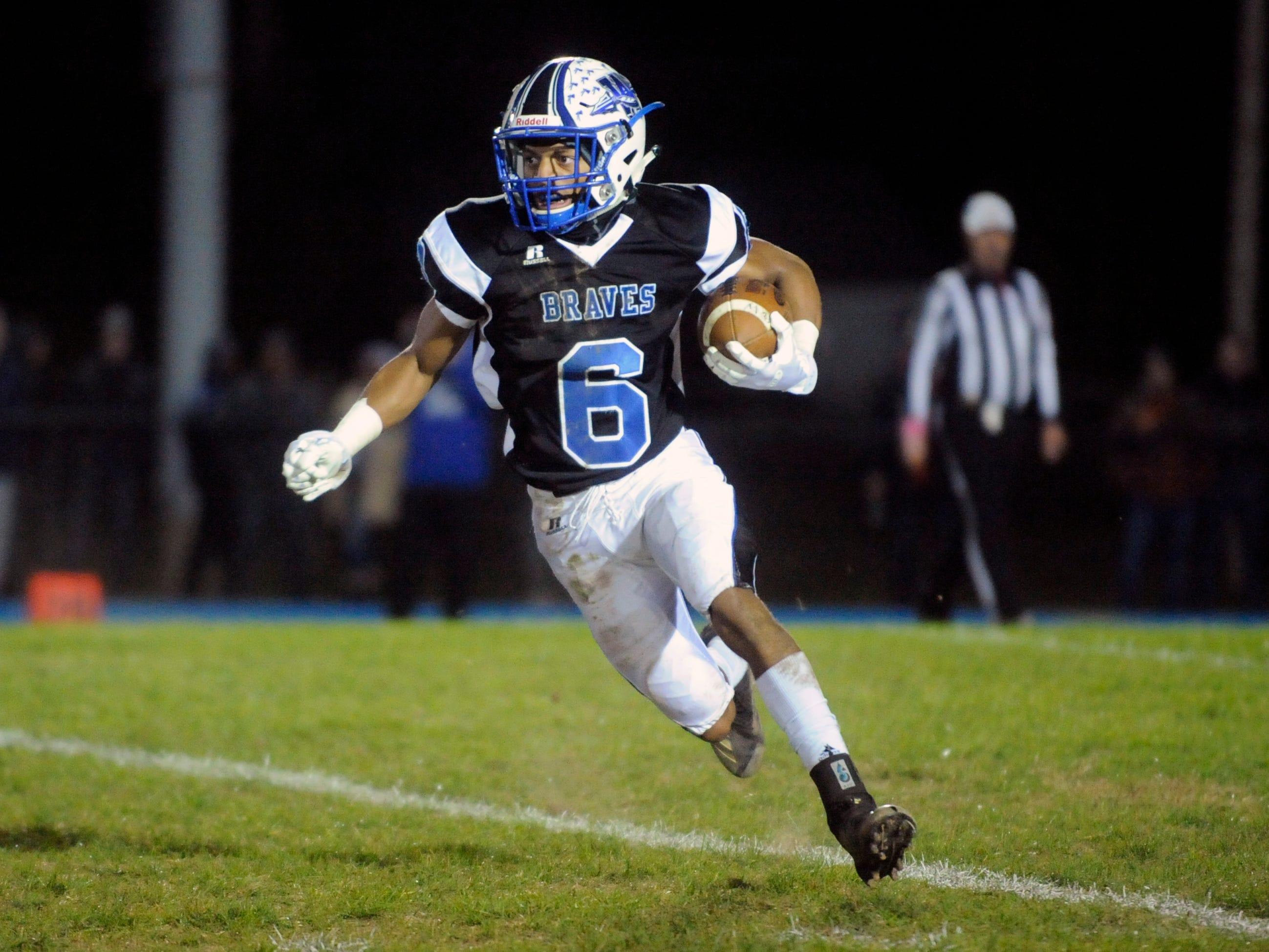 Williamstown's Damonte Campbell runs for a gain against visiting St. Augustine. The Braves topped the Hermits, 14-7, on Friday, October 26, 2018.