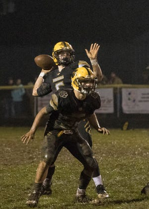 Paint Valley's Bryce Newland looks for an opening to throw the ball Friday night at Paint Valley High School. Paint Valley defeated Adena 16-3, making them this year's gold ball recipient.