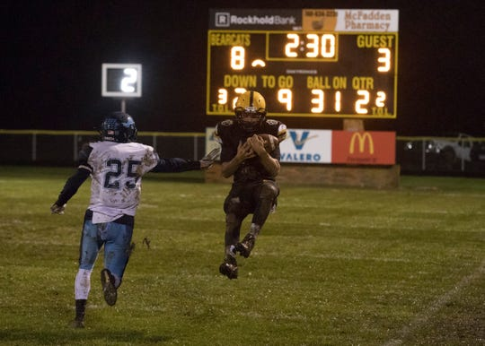 Paint Valley's Cruz Mcfadden catches a pass thrown by Bryce Newland Friday night at Paint Valley High School. Paint Valley defeated Adena 16-3, making them this year's gold ball recipient.