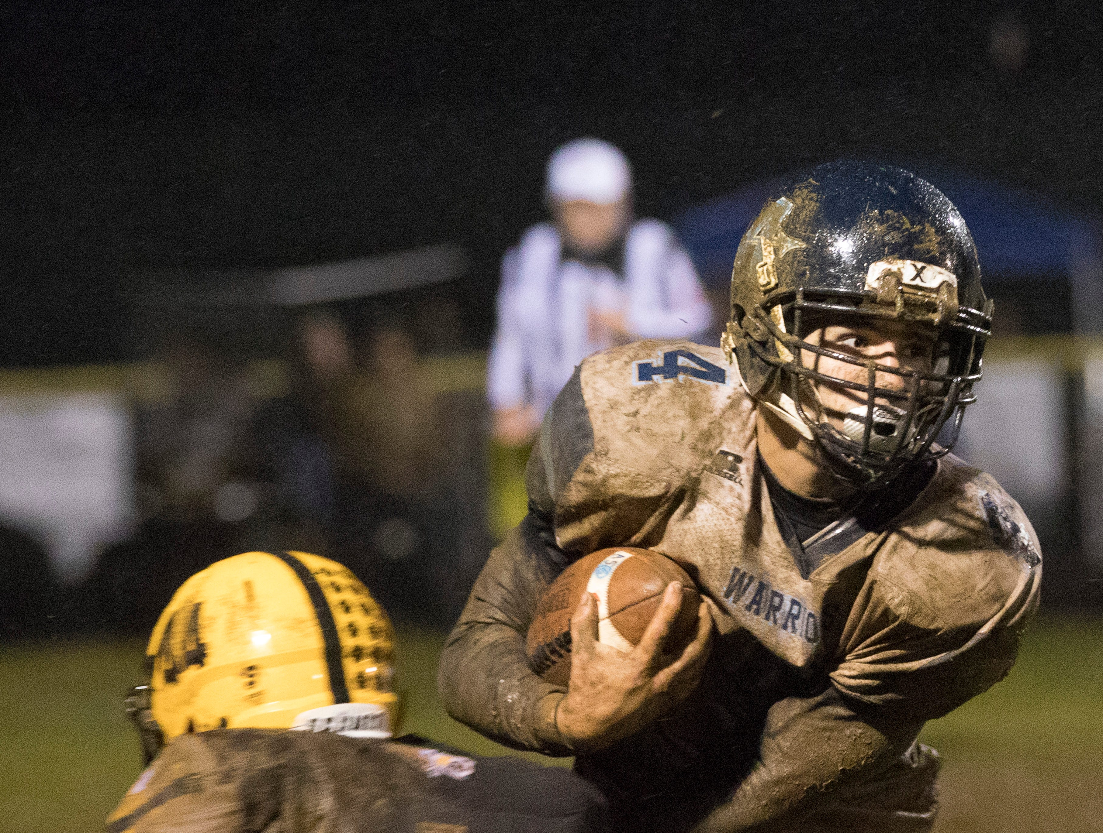 Adena tries to run the ball past Paint Valley Friday night at Paint Valley High School. Paint Valley defeated Adena 16-3.
