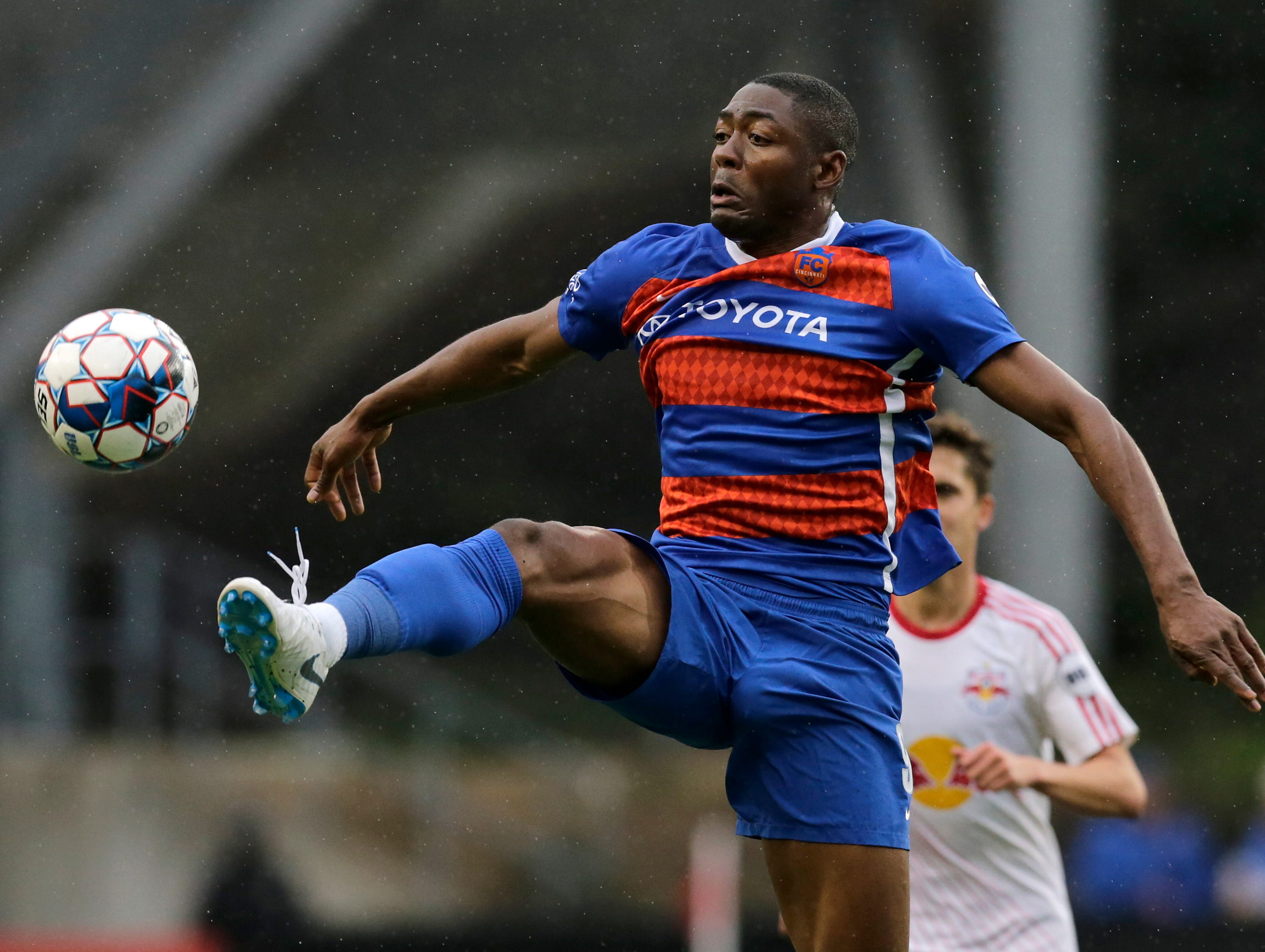 FC Cincinnati forward Fanendo Adi (9) stretches for a kick in the first half of the USL Eastern Conference Semifinal match between the FC Cincinnati and the New York Red Bulls II at Nippert Stadium in Cincinnati on Tuesday, Oct. 16, 2018. New York Red Bulls II led 1-0 at half time.