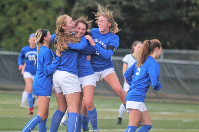 Highlands players celebrate the first goal of the game by Kenzie Nehus, middle, during a KHSAA girls soccer state quarterfinal with Highlands facing Greenwood Oct. 27, 2018 at Paul Laurence Dunbar HS, Lexington KY. Highlands won 3-1.