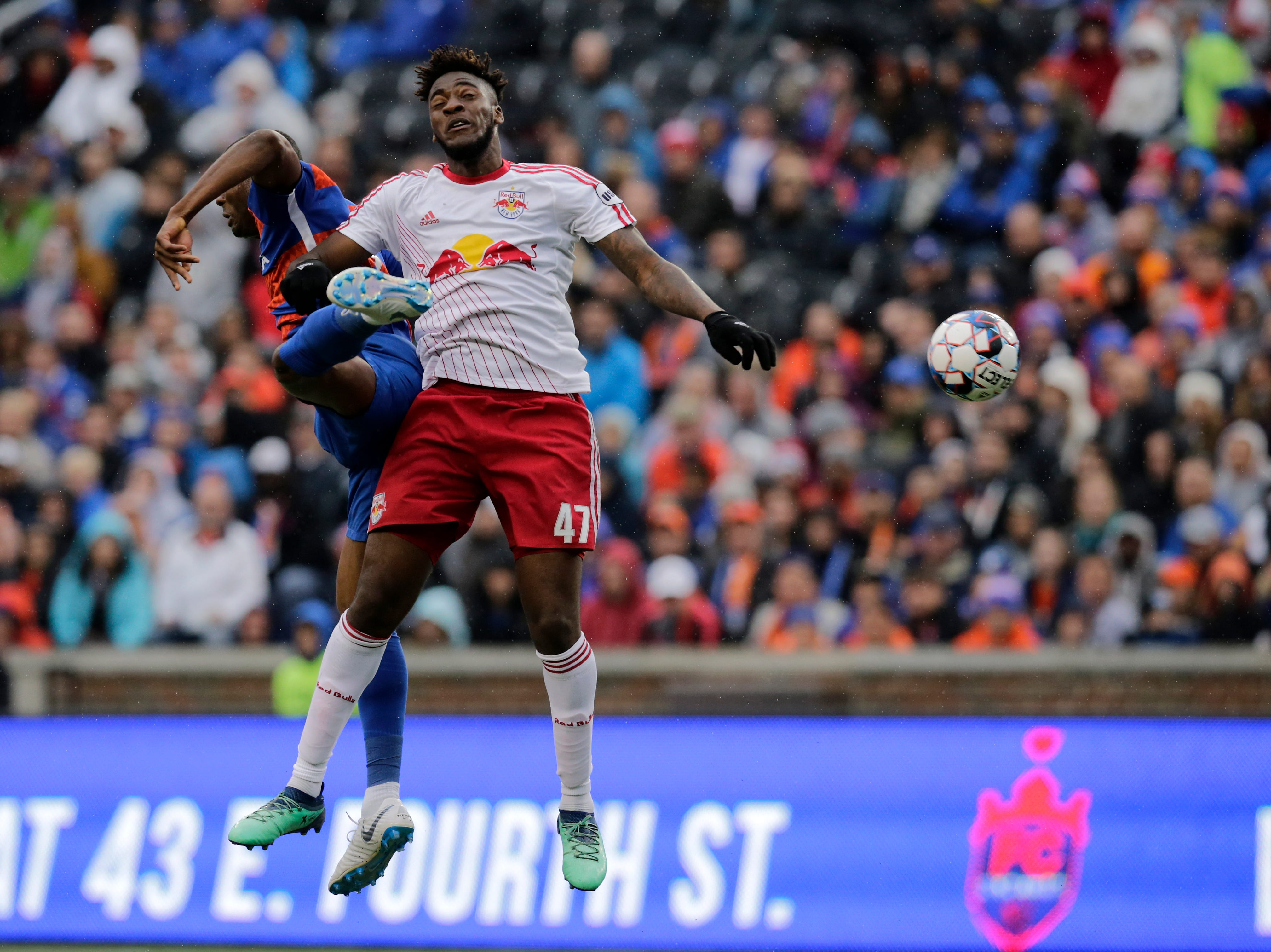 FC Cincinnati forward Fanendo Adi (9) and New York Red Bulls II defender Hassan Ndam (47) collide over a ball in the first half of the USL Eastern Conference Semifinal match between the FC Cincinnati and the New York Red Bulls II at Nippert Stadium in Cincinnati on Tuesday, Oct. 16, 2018. New York Red Bulls II led 1-0 at half time.