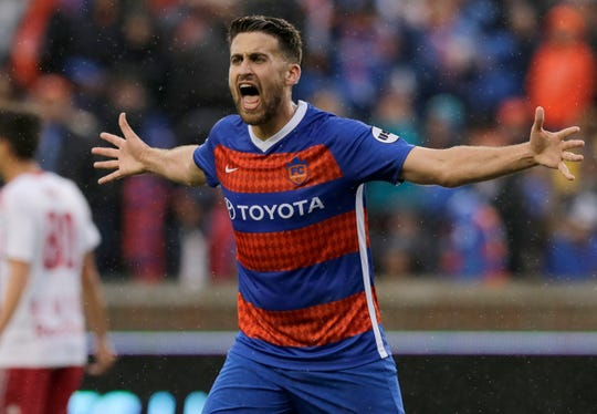 FC Cincinnati midfielder Nazmi Albadawi (5) shouts at an official in the first half of the USL Eastern Conference Semifinal match between the FC Cincinnati and the New York Red Bulls II at Nippert Stadium in Cincinnati on Tuesday, Oct. 16, 2018. New York Red Bulls II led 1-0 at half time.
