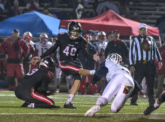 East Central kicker Caden Browndyke (48) kicks a game winning field goal late in the game against S. Dearborn in the IHSAA playoffs at East Central High School, Friday, Oct. 26, 2018, St. Leon, IN