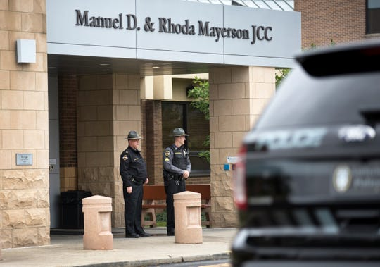 Amberly Village Police Chief Richard Wallace, left, and Sgt. Tiom Schmidtgoessling, stand guard outside the Manuel D. & Rhoda Mayerson JCC in Amberly Village. Amberly is just outside the city of Cincinnati, OH. Chief Wallace said the beefed up security was in response to the shooting near the synagogue in Pittsburgh. Three police vehicles were parked outside the large facility. The Jewish Community Center is an active place that offers wellness, recreation, a variety of classes and a senior center.