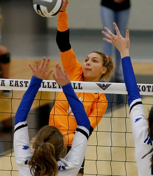 Mercy McAuley's Taylor Drapp returns a volley to Springboro to Springboro during their Division I Southwest district chanpionship volleyball game at Lakota East in Liberty Twp. Saturday, Oct. 27, 2018.
