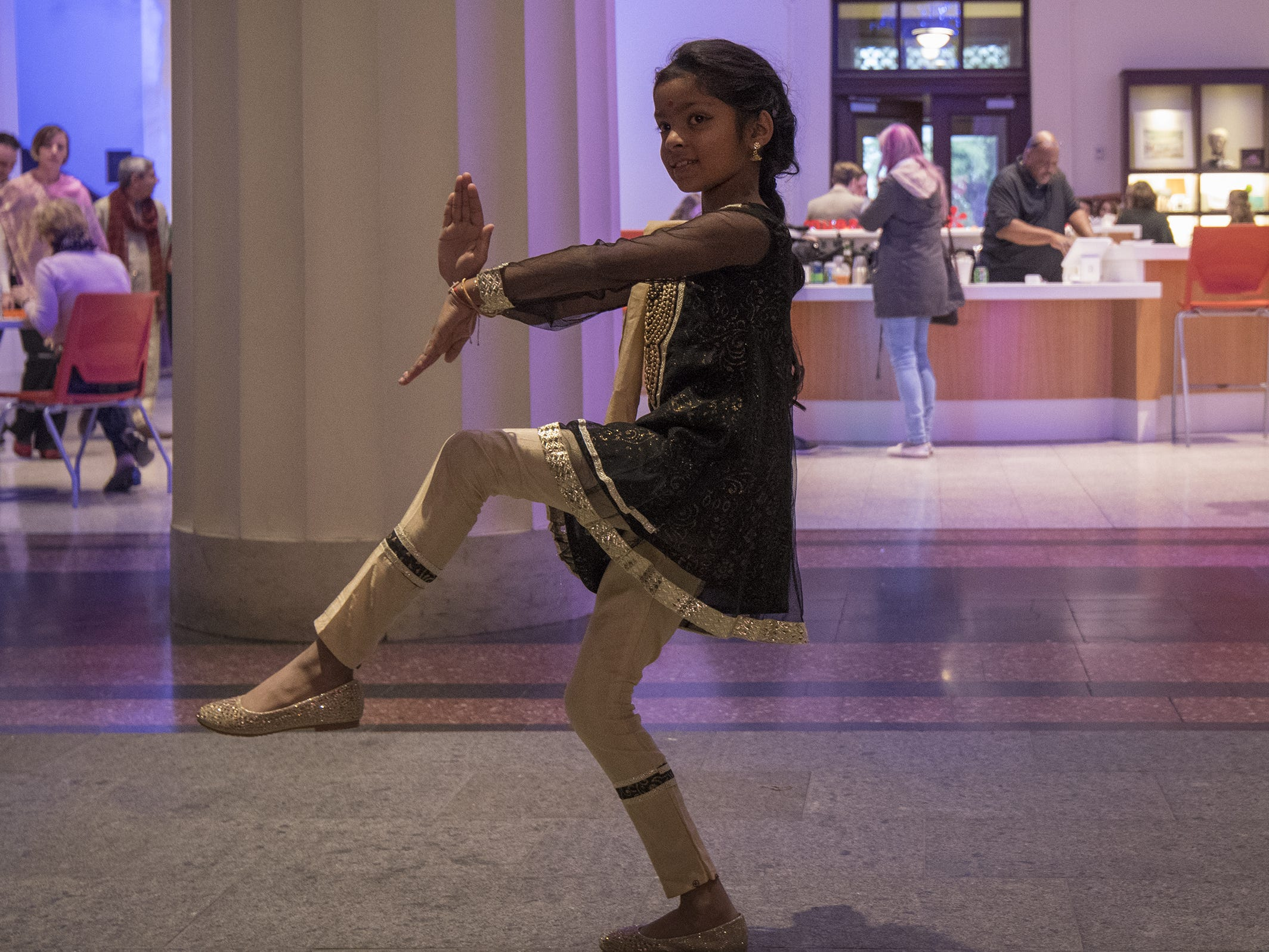Sashti Subramanlam, 8, of West Chester poses for a photo during Art After Dark at the Cincinnati Art Museum Friday, Oct. 26. The after-hours party celebrates the new exhibition, the Fabrics of India.