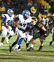 MiChale Wingfield (17) breaks around the Moeller defense on a long run for Winton Woods, October 26, 2017.