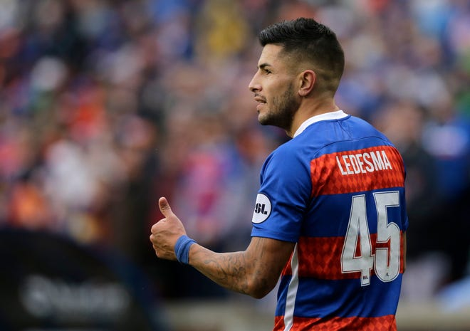 FC Cincinnati midfielder Emmanuel Ledesma (45) pumps up the crowd in the second half of the USL Eastern Conference Semifinal match between the FC Cincinnati and the New York Red Bulls II at Nippert Stadium in Cincinnati on Tuesday, Oct. 16, 2018. FC Cincinnati was eliminated from the playoffs with a 1-0 loss to New York.