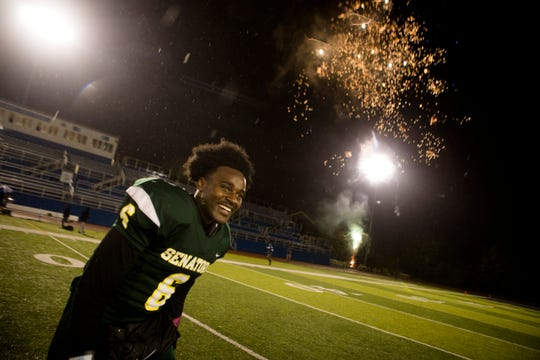 Taft's Cleveland Farmer celebrates after the OHSAA final regular season game between Taft High School and Aiken High School on Friday, Oct. 26, 2018 at Stargel Stadium in the West End. Taft defeated Aiken 28-8.