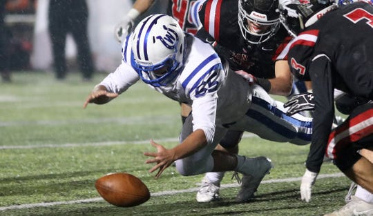 Wyoming lineman Shep Marty recovers a fumble for the Cowboys  during their football game against Indian Hill, Friday, Oct.26, 2018.