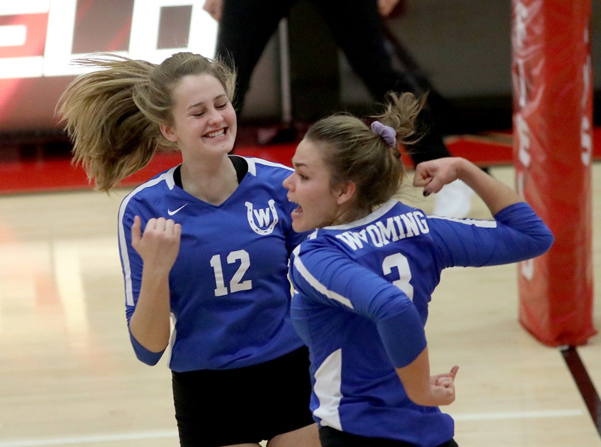 Wyoming players Ines Grom (3) and  Bea Goodin react during the Cowboys district volleyball game against Bishop Fenwick, Saturday, Oct. 27,2018.