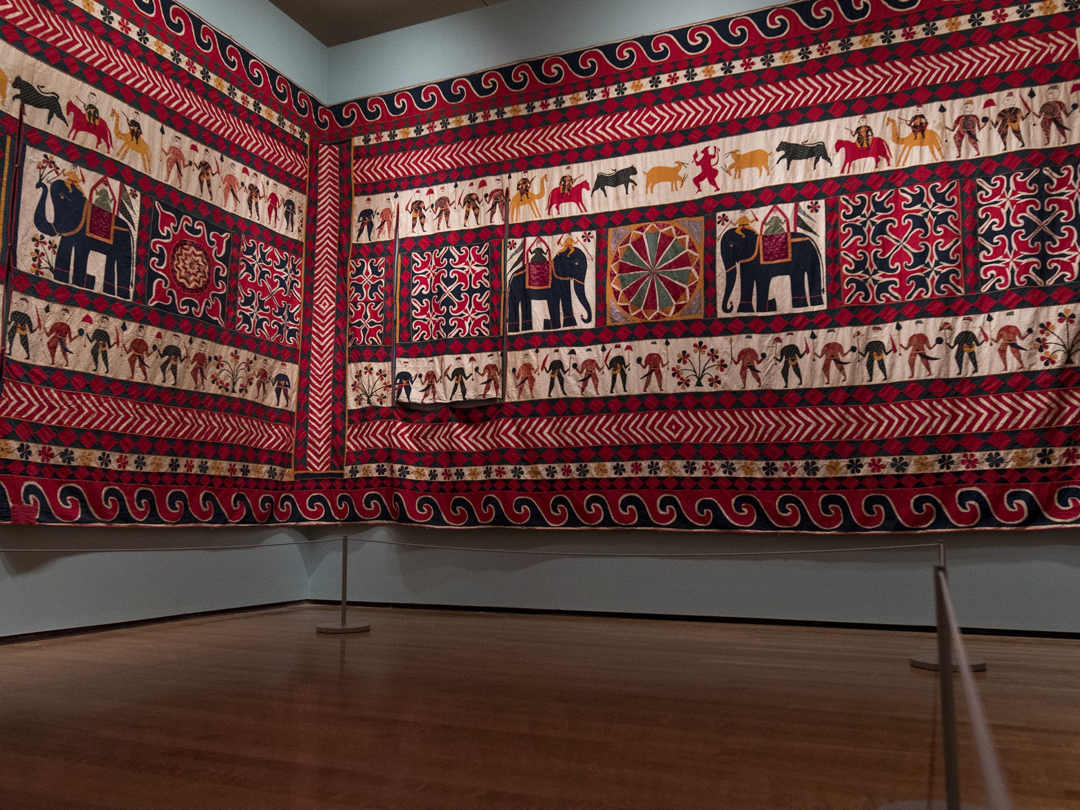 Huge silk panels line the walls in a part of the new Fabrics of India exhibit at the Cincinnati Art Museum.