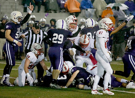 Elder players signal a fumble recovery against LaSalle during their game at The Pit in Cincinnati Friday, Oct. 26, 2018.