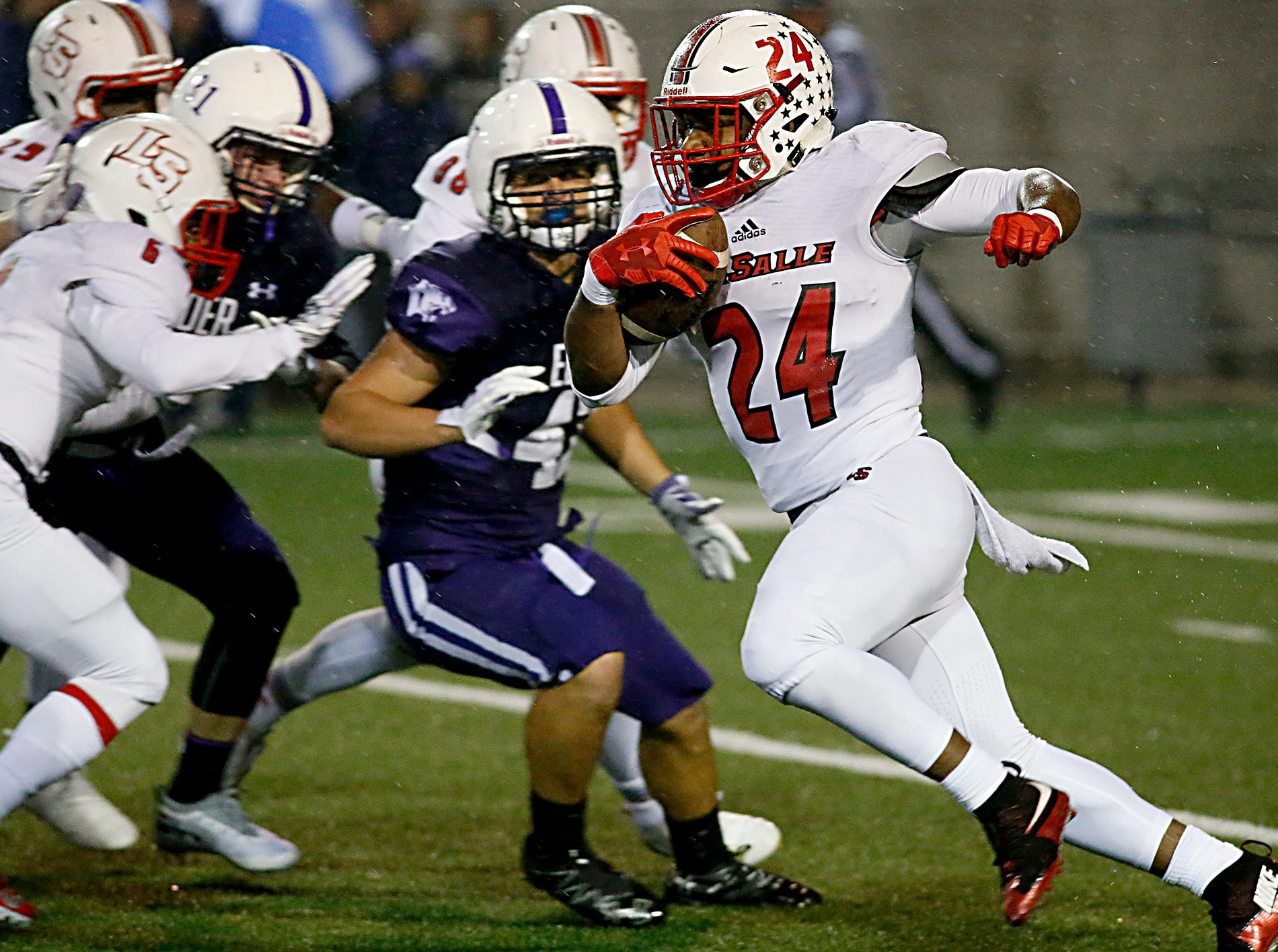 La Salle running back Cameron Porter carries the ball against Elder during their game at The Pit in Cincinnati Friday, Oct. 26, 2018.