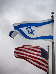 The Israeli flag flies along with the US flag in front of the Manuel D. & Rhoda Mayerson JCC in Amberly Village outside Cincinnati, OH.