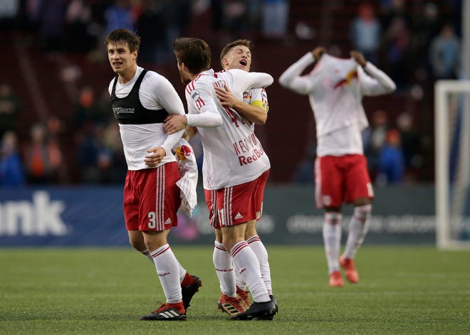 New York Red Bulls II celebrate at the end of the second half of the USL Eastern Conference Semifinal match between the FC Cincinnati and the New York Red Bulls II at Nippert Stadium in Cincinnati on Tuesday, Oct. 16, 2018. FC Cincinnati was eliminated from the playoffs with a 1-0 loss to New York.