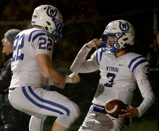 Wyoming quarterback Evan Prater celebrates with Pierson Rogers (22) after scoring a touchdown  during their football game against Indian Hill, Friday, Oct. 26, 2018.