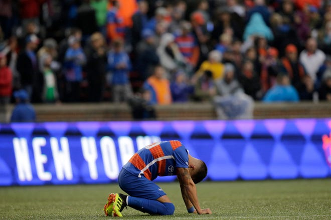 FC Cincinnati midfielder Emmanuel Ledesma (45) falls to his knees at the end of the second half of the USL Eastern Conference Semifinal match between the FC Cincinnati and the New York Red Bulls II at Nippert Stadium in Cincinnati on Tuesday, Oct. 16, 2018. FC Cincinnati was eliminated from the playoffs with a 1-0 loss to New York.