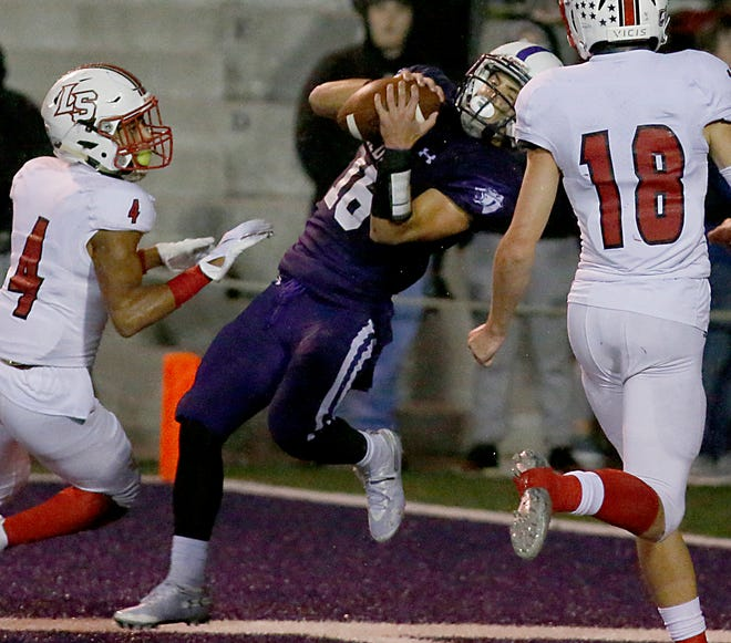 Elder wide receiver Kyle Trischler makes a catch in the end zone against LaSalle during their game at The Pit in Cincinnati Friday, Oct. 26, 2018.