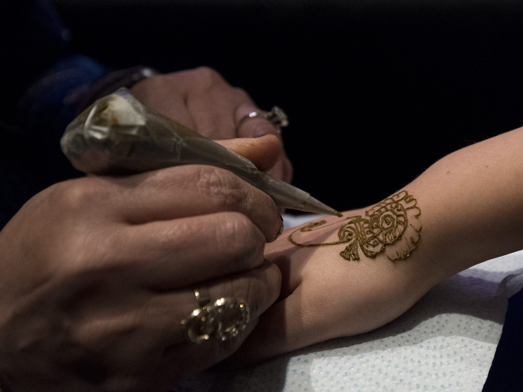 A guest gets a henna tattoo by Sonal Modi during Art After Dark at the Cincinnati Art Museum.