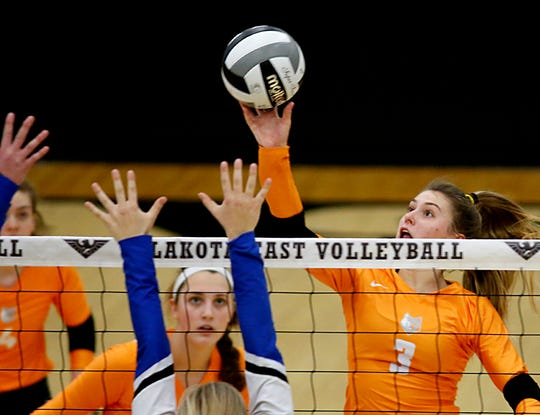 Mercy McAuley's Shelby Dennis returns a volley to Springboro during their Division I Southwest district chanpionship volleyball game at Lakota East in Liberty Twp. Saturday, Oct. 27, 2018.