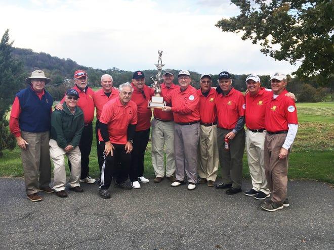The Warrenbrook Senior Golf Team celebrates their secondconsecutive Senior League Championship.