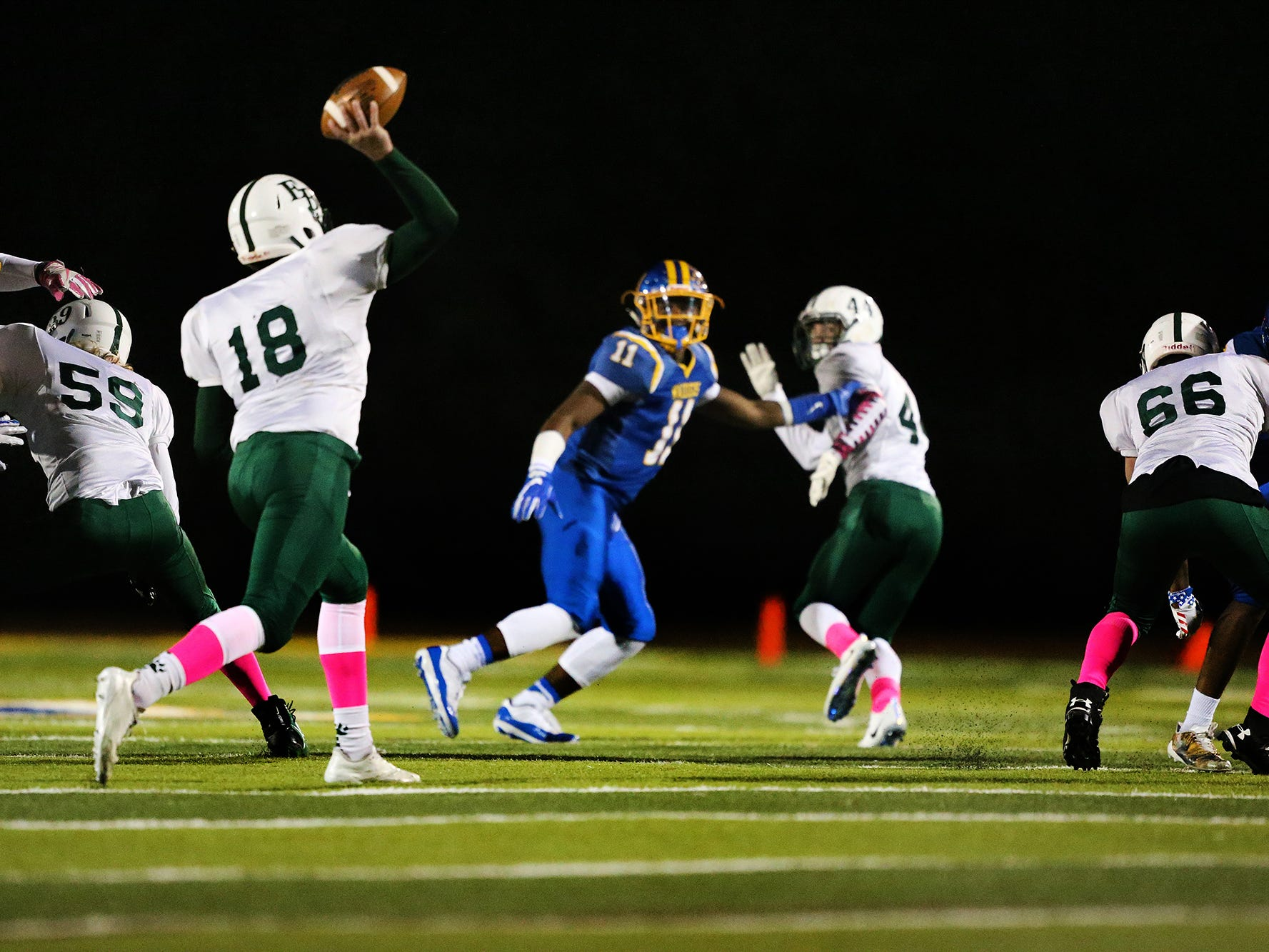 East Brunswick quarterback Tim Gudzak (18) throws a pass during the first half Friday, Oct. 26, 2018.