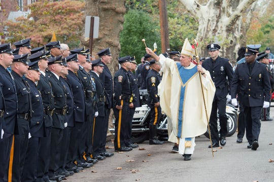 Bishop James F. Checchio reviews and blesses the troops after the 2017 Blue Mass at the Cathedral of St. Francis of Assisi, Metuchen. The Phillipsburg Police Department will serve as the host agency of the Mass this year.