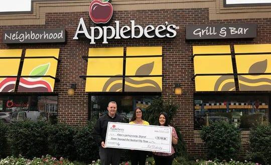 (Left to right)John Antosiewicz, area director, Applebee's New Jersey; Liz Scott, executive director, Alex's Lemonade Stand and Alex's mom; Rachel Gaida, general manager, Applebee's Parsippany.