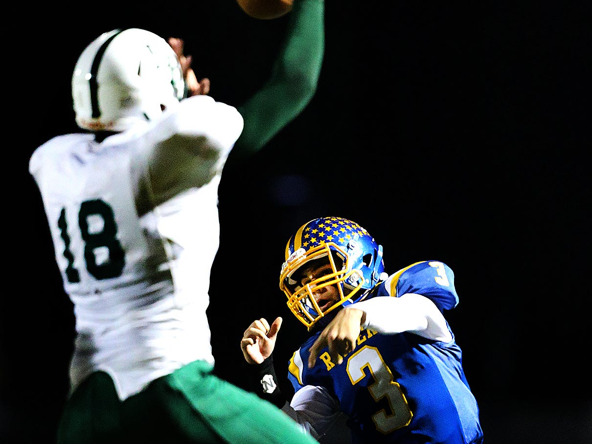 North Brunswick's Christian Petrillo (3) throws over East Brunswick's Tim Gudzak during  the first half on Friday, Oct. 26, 2018.