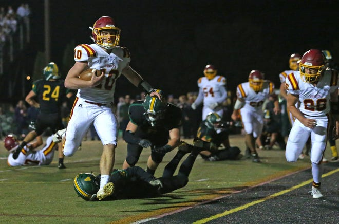Voorhees quarterback George Eberle (10) gets past North Hunterdon's Dylan Farina (4) to score a touchdown during the first half Friday, Oct. 26, 2018 at North Hunterdon High School.