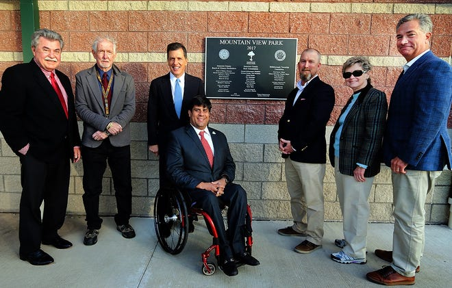 Surrounding the new plaque at Mountain View Park in Hillsborough are, left to right, former Somerset County Parks Director Ray Brown, Park Commission President Bill Crosby, Freeholder Mark Caliguire, Freeholder Director Patrick Scaglione, Park Commissioners Scott Ross and Helen Haines, and interim Parks Director Geoffrey Soriano.