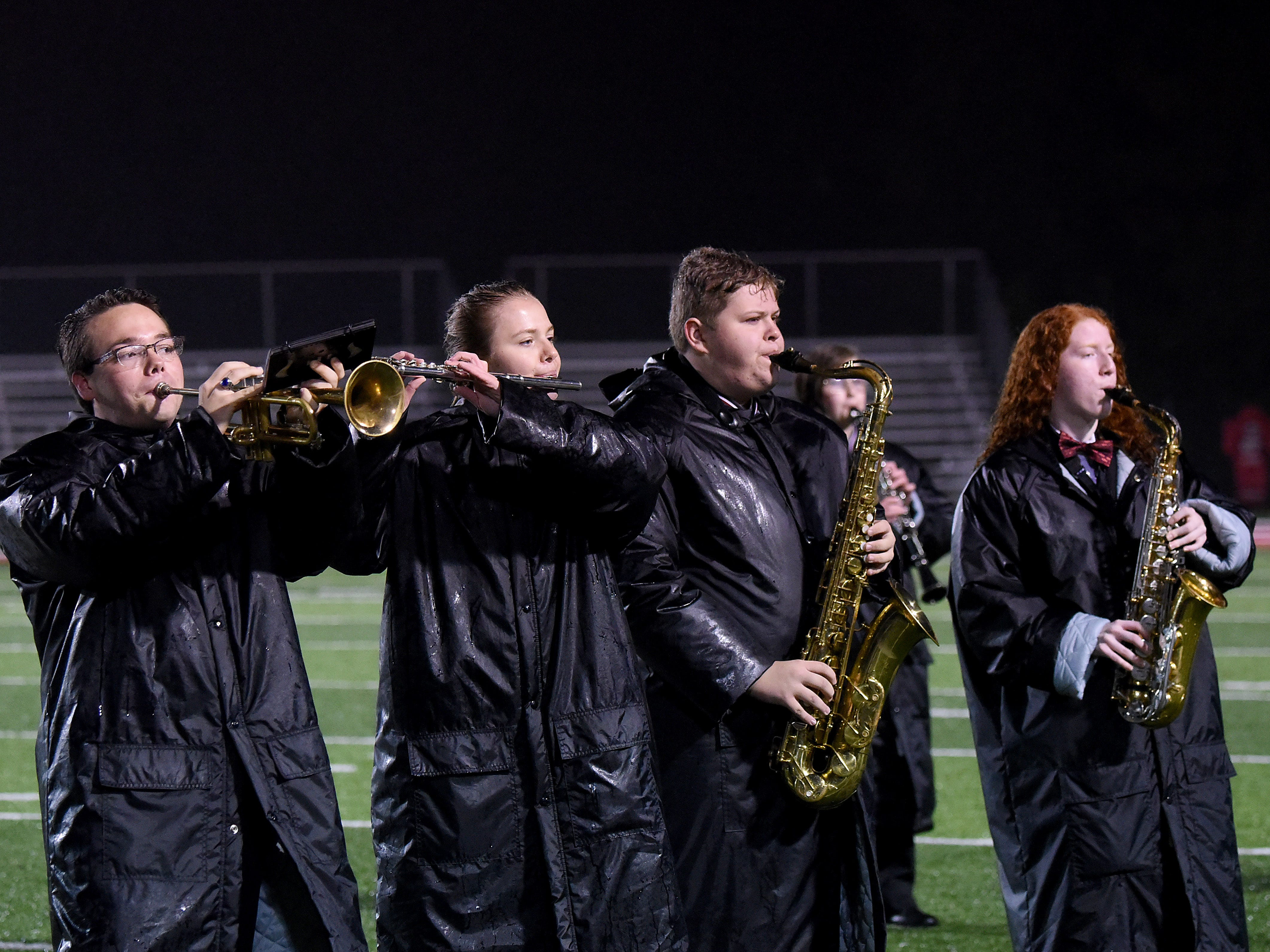 Coshocton High School marching band seniors Tyler Huston, Jenna Stonebraker, Graham Beaumont, and Sarah Heading perform for the last time on their home turf on Friday, Oct. 26, 2018.