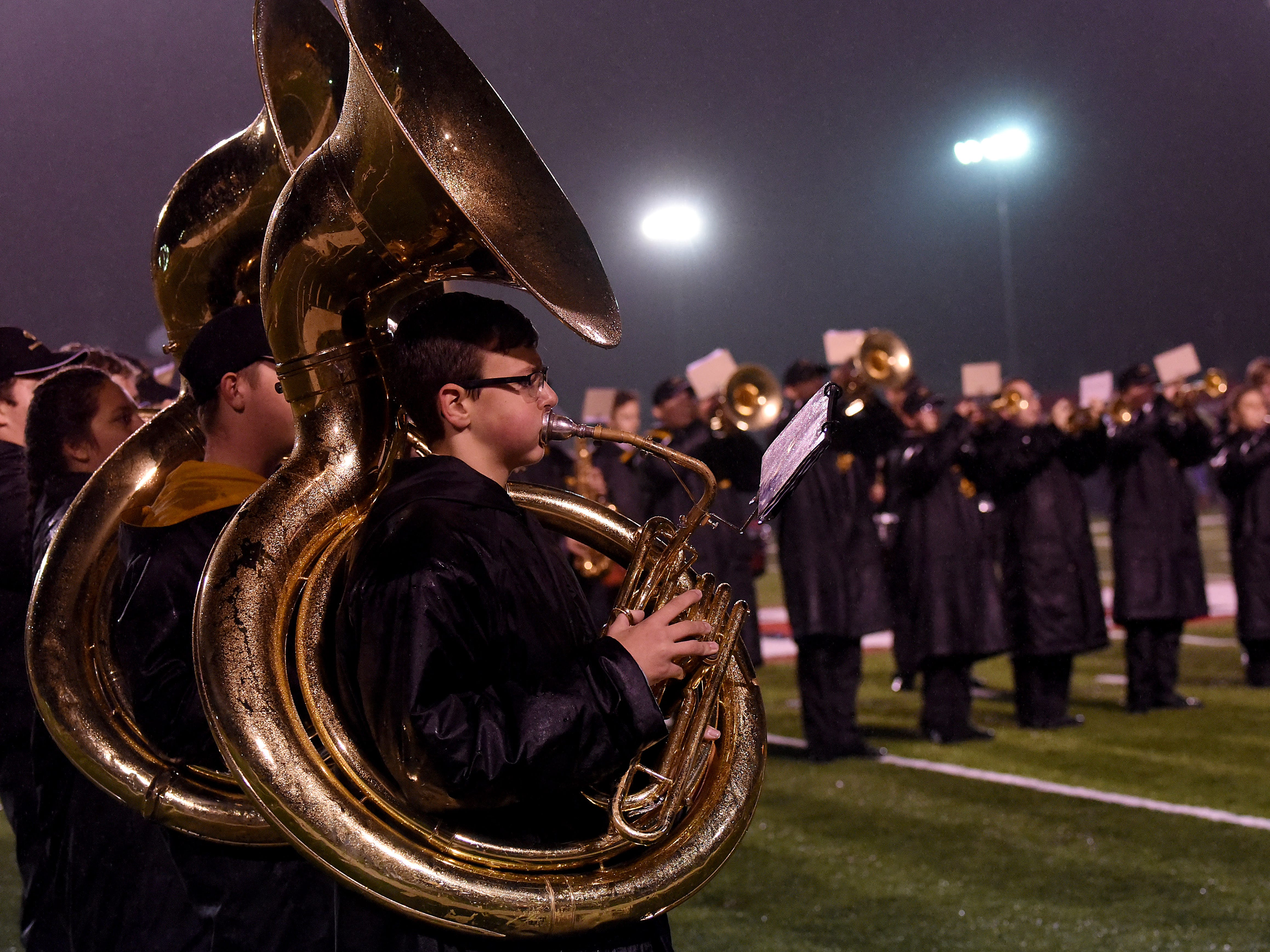 Coshocton tubaist Sheldon Stotts performs with both the Coshocton and River View bands during a rainy halftime show on Friday, Oct. 26, 2018,